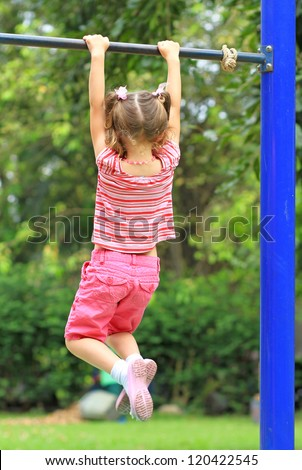 Young girl holding on the bar