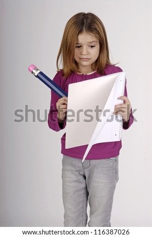 young girl holding pencil