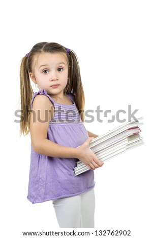 young girl holding stack of heavy books with surprised look on her face with copy space for your text isolated on white background - education concept