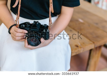 young girl holding vintage film camera #333661937