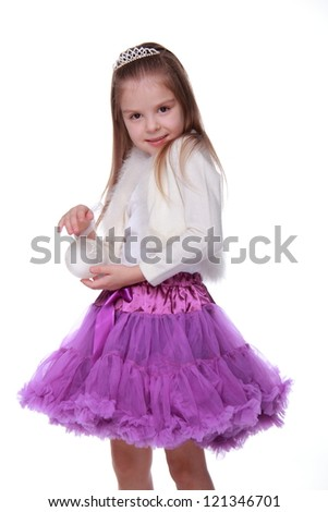 Young girl holding white decorative Christmas ball on Holiday theme