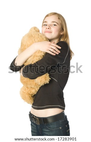 Young girl hugging a Teddy bear, isolated