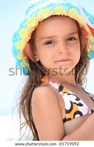 stock photo young girl in a bikini and sunhat 81719092 Young bikini girl pointing a finger Royalty Free Stock Photo