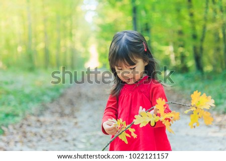 Stock Photo Young girl in a forest in autumn