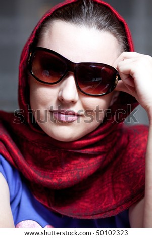 Young girl in a red shawl
