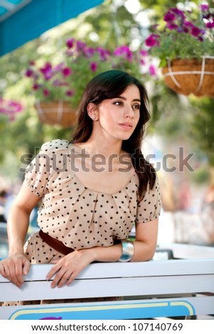 young girl in a summer cafe