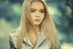 Young girl in autumn portrait, blond adult