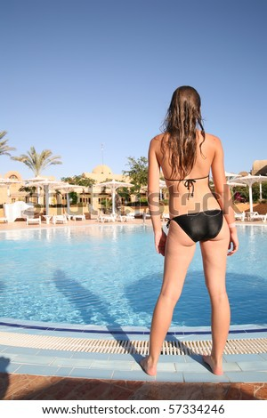 stock photo young girl in bikini against pool at resort hotel 57334246 Sensual blond young girl in