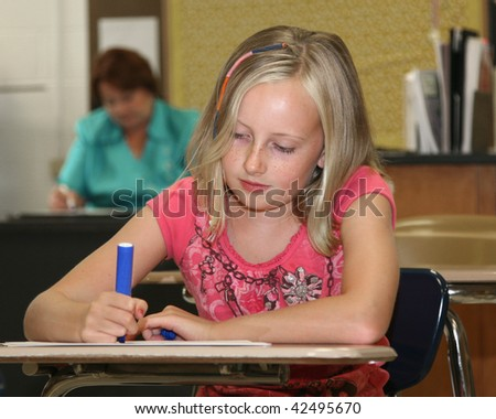 Young girl in classroom with teacher