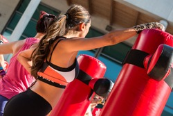 Young Girl in Fitness Sportswear and Punching Bags, Female Kickboxing Exercise in Outdoor Gym