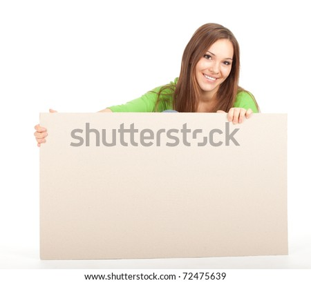 young girl in green blouse holding blank poster
