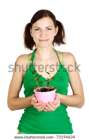 young girl in green shirt holding potted plant and smiling, isolated