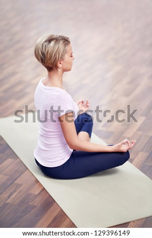 Young girl in lotus position - stock photo