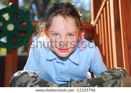 Young girl in playhouse with afternoon sun