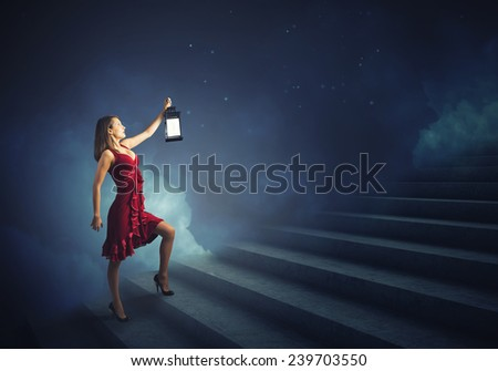 Stock Photo Young girl in red dress walking on stair case