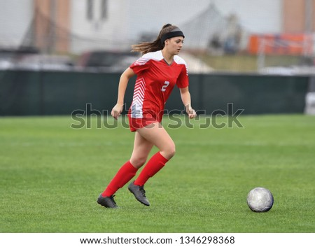 17b314655 Young girl kicking soccer ball on field Images and Stock Photos ...