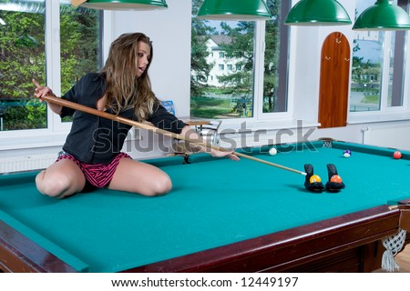 Young girl in short skirt playing snooker