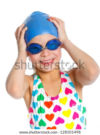 Young girl in swimsuit and swimming goggles over white background
