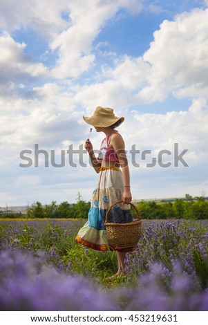 Young girl in the field of lavender in Provence #453219631