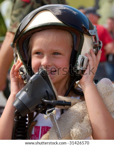young girl in the pilot helmet