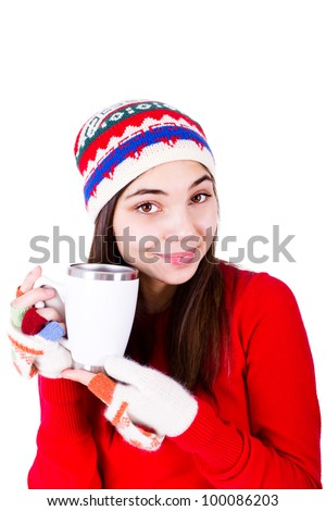 Young girl in winter clothes holding a coffee cup with copy space on it. Wearing Winter hat and fingerless glowe. Isolated on white background.