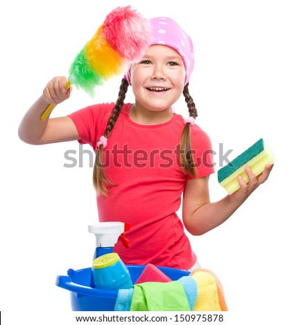 Young girl is dressed as a cleaning maid, holding static duster and sponge, isolated over white