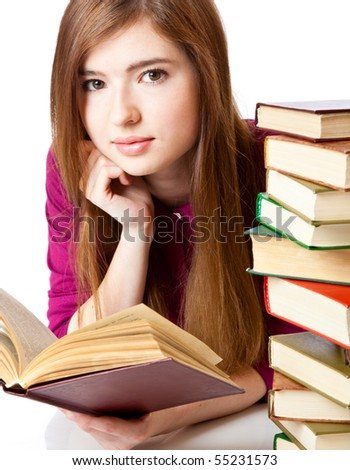 Young girl is lying on a floor and reading book. Isolated on white background
