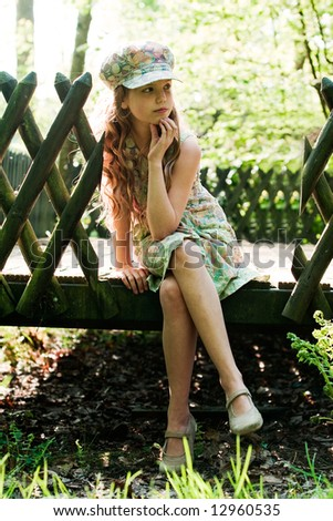 Young girl is presenting her clothes while she is sitting