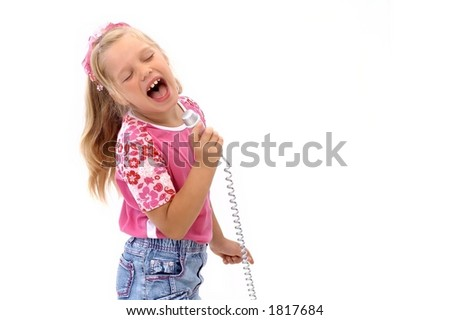 Young girl is singing with a microphone