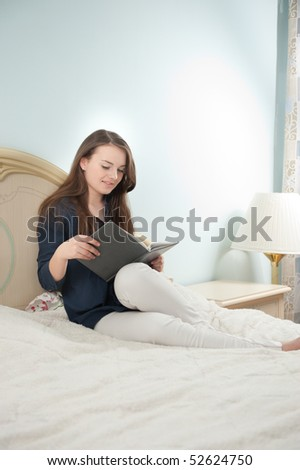 Young girl is studying in bedroom