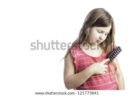 Young girl isolated on white brushing her long hair