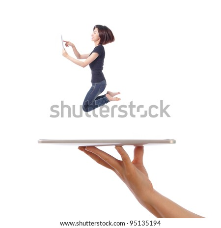Young girl jump and using tablet pc on a people hand isolated on white background, model is a asian beauty