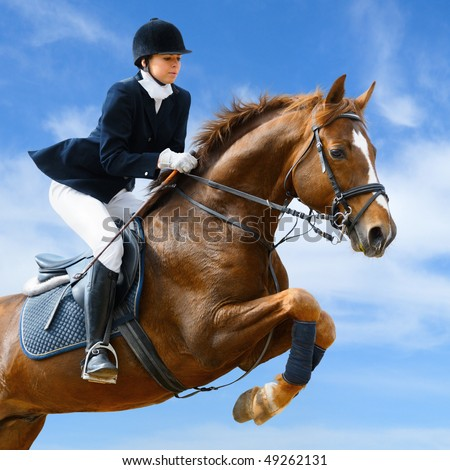 Young girl jumping with sorrel horse #49262131