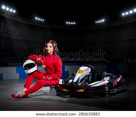 Young girl karting driver at sports hall