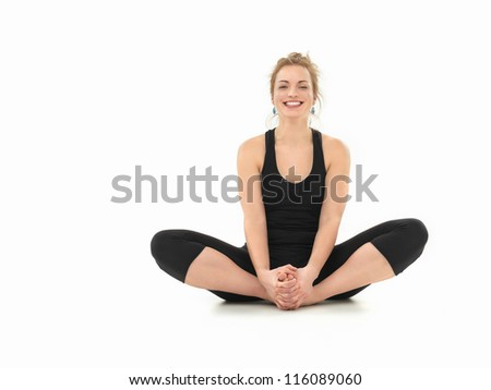 young girl laughing, in yoga pose, full frontal view, black costume, on white background