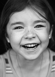 Young girl laughing with a great smile.