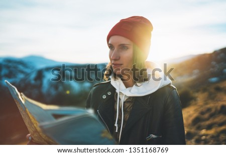 young girl look and hold in hands map, people planning trip, hipster tourist on background sun flare nature, enjoy journey landscape vacation trip, lifestyle holiday concept, sun mountain #1351168769