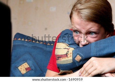Young girl looking at something frightening