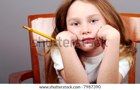Young Girl Looking Bored Holding Pencil