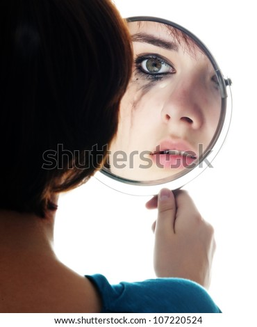 young girl looking in the mirror and crying - sensitive eyes