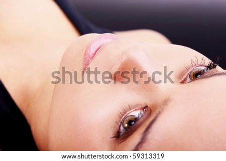 Young girl looking up, Face close up, high angle