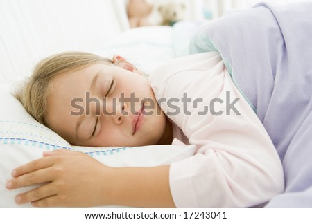 Young Girl Lying Down In Her Bed