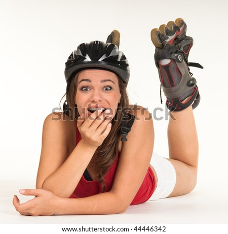 Young Girl lying down with inline skates