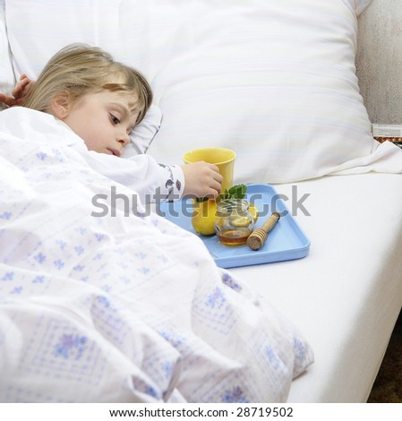 Young girl lying in bed with flu
