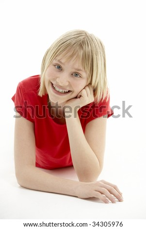 Young Girl Lying On Stomach In Studio - stock photo
