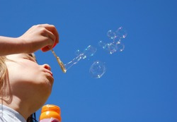 Young Girl makes Blow Bubbles