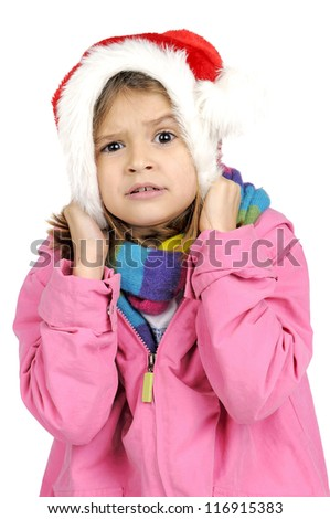 Young girl making faces with Santa's red hat