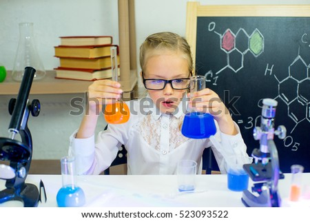 young girl making science experiments in laboratory. education