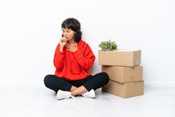 Young girl moving in new home among boxes isolated on white background is suffering with cough and feeling bad
