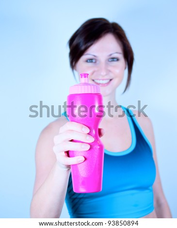 Young girl offering a bottle of water